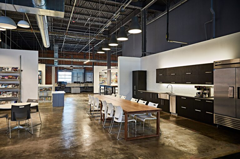 CD Companies kitchenette/lunch room with long wood table and dark wood cabinets